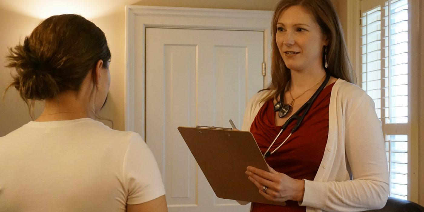 Naturopathic doctor with patient